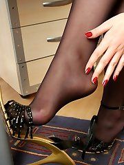 Fiery sec stripping up to her dark pantyhose and stroking her nyloned feet