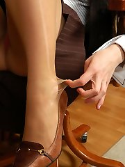 Kinky secretary in silky pantyhose having fun while playing with her feet