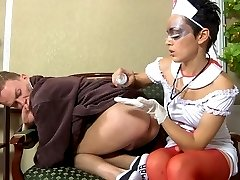 Nasty nurse fingers and strapon fucks the butt of her obedient male patient