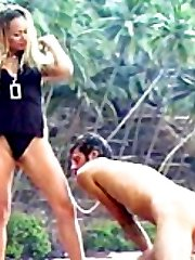 Gorgeous mistress schools her male slave with doggie walk and face sitting on a tropical beach