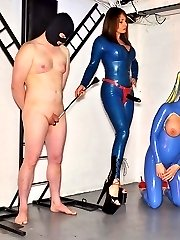 Mistress Carly fucks her gimp and latex sex doll with her big black strapon, then instructs her...