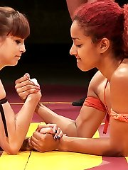 This is a tag match on a temporary set. The US girls are ready and willing to fight on any mat...