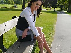 Hot babe Maria teases her sexy legs and shiny black high heel shoes in the park