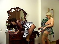 Kinky guy arrives at the scene cross-dressed going for hot strap-on fucking