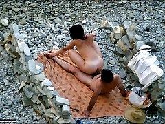 A wild couple have steamy beach sex near the sea