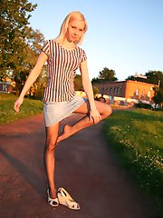 Frisky blonde boasting her nylon covered feet and pantyhosed pussy outdoors