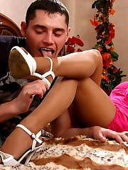 Pretty babe gets her suckable feet in tan tights licked and smeared in cum
