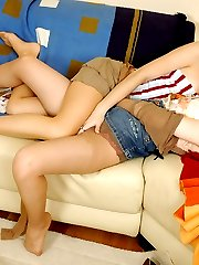 Lesbian chick massaging itchy clit while licking pussy through pantyhose