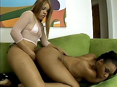 Pleasure Bunny shoves her huge strap on cock into a hot black lesbian pussy in this sexy scene