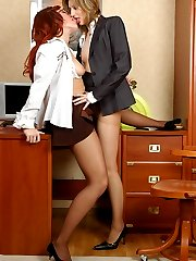 Lusty office gal seducing a lady-boss into steamy nylon sex right at work