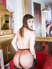 Roxy peels off a black satin dress to reveal some fantastic designer pantyhose in an unusual...