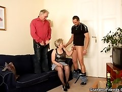 Granny shows her affinity for cock by pleasuring both of these guys very well
