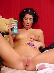 Naughty brunette fondling her plump jugs