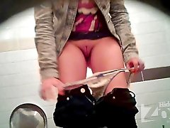 Toilet video a view from the two cameras. Young babe climbed on the toilet with her legs and pee...