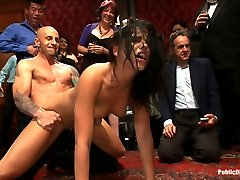 Blindfolded and locked into a box where only her pussy, ass, and feet are free, 21 year old...