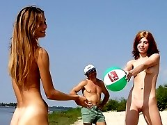 Thin young teen nudists play at the nude beach