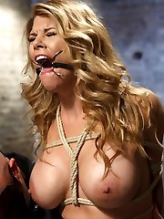 Hot slutty blonde Carissa Montgomery gets her big tits tied by Sgt. Major. Carissa is gagged and...