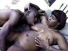Sex-starved ebony loving a black dick in her cock-hungry mouth.