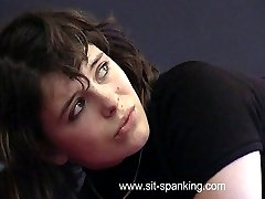 Bare bottom spanking in the cell block for firm assed girl bent over in pain