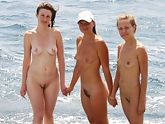 Posing naked on the beach