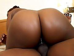 Ebony BBW Ya Ya slides upon a thick cock