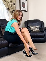 Girl next door Debbie puts on a sexy home tease just for you wearing her silky nylons and shiny...