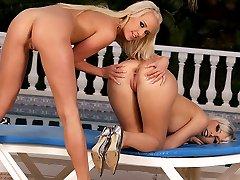 Two bikini babes enjoy cunnilingus