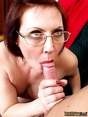 Sex-addicted 45 y.o. woman in eye-glasses and stockings enjoys oral sex with a young guy