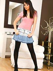 Breathtaking Rachael B in a tight top, denim miniskirt and black pantyhose.