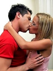 Pretty milf blondie enjoys hard fucking with a younger guy then strapon fucks him