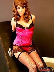 Dakota looks stunning in her hot pink satin corset and fishnets and even better when she strips...