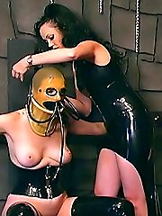 Mistress in latex dress ropes a female slave thus punishing her for disobedience