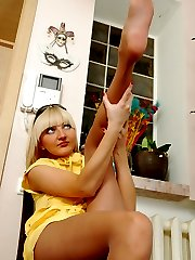 Sexy blondie slowly strips her soft silky pantyhose and shows her yummy feet