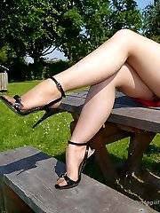 Hot blonde Milf Larissa wants you to join her and her beautiful long shiny legs for some fetish...