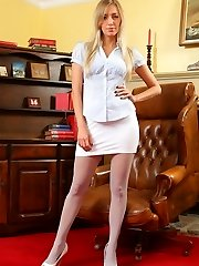 Hayley-Marie looks sensational in her tight blouse, white miniskirt and matching high heels.