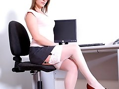 Secretary flashes her stocking tops and panties