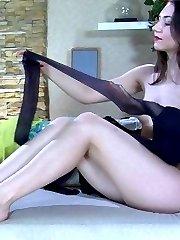 Dark-haired nylon teaser flashes her white thong thru sheer black pantyhose