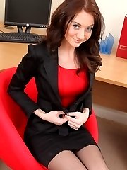 Beauty in black miniskirt suit.