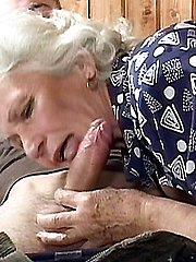 Granny Erin lays on her sides getting her pussy spoon fucked by a younger guy