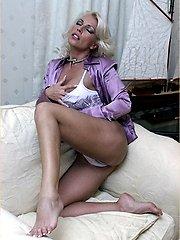 Leggy Milf Lana Cox peels off her nylon panties for a naughty play on the sofa