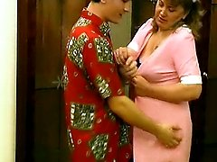 He finds the maid in the bathroom and his hands are all over her sexy mature body.