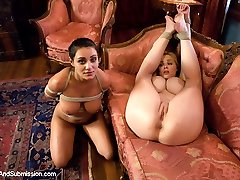 Charley Chase and Katie Kox are hot and busty submissives in this great role play shot in the...