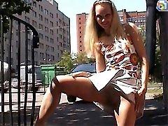 Public nudity of a smiley slim blondie