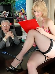 Slutty young secretary luring her graying boss into hot quickie on the desk