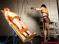 Femdom Dahlia straps her slave down to a medical table and shoves a dental gag in his mouth....