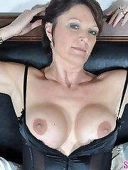 Sexy MILF Angela teases in black lingerie