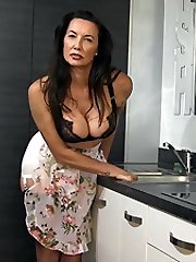 Every man, or woman, should come home to a welcome sight just like sexy housewife Nylon Jane! A...