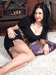 Slim big tit babe Louise masturbates in her nylons and girdle on the rug