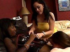 Two ebony babes toying one white pussy