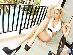 Huge Boobs Blonde posing on the Balcony at a Posh Resort